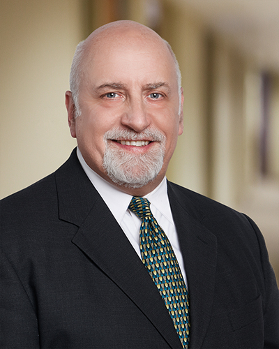 Workers Compensation Attorney Roger Willhaus of Fitch, Johnson, Larson and Held, P.A.